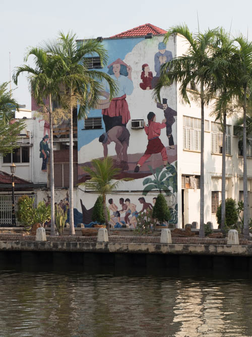 side of building artwork on Melaka River